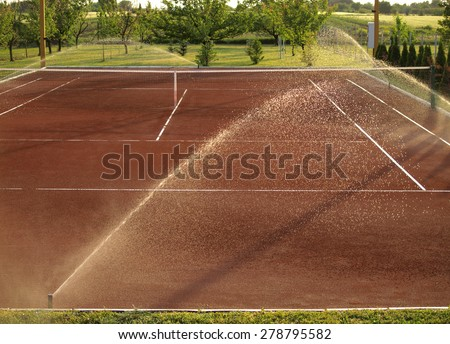 Tennis court watering - stock photo