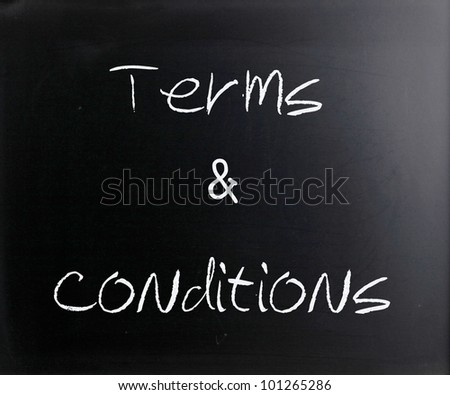 """Terms & Conditions"" handwritten with white chalk on a blackboard. - stock photo"