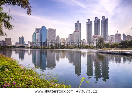22th August 2016 Bangkok Thailand : city buildings and reflection in water at Benjakiti park near Queen Sirikit convention center in Bangkok Thailand