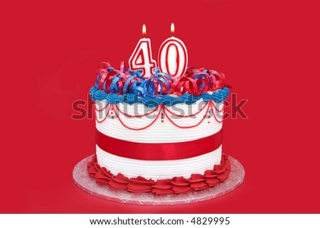 40th cake with numeral candles, on vibrant red background. - stock photo