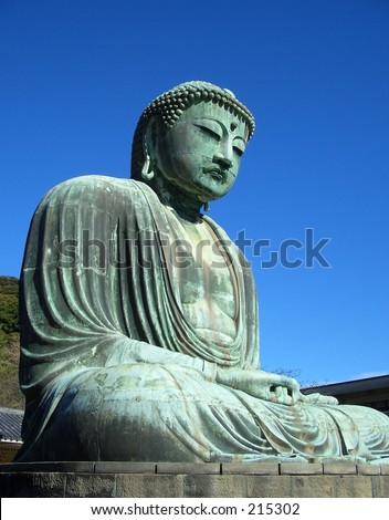 15th Century bronze statue of Buddha in Kamakura Japan, near Tokyo.  This statue is 11.5 meters high, and is the second largest Buddha in Japan. - stock photo