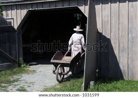 19-th century countrywoman entering a shed