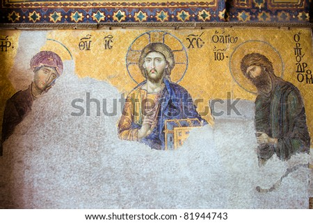 13th century Deesis Mosaic of Jesus Christ (known as Christ Pantocrator) flanked by the Virgin Mary and John the Baptist in the Hagia Sophia temple in Istanbul, Turkey