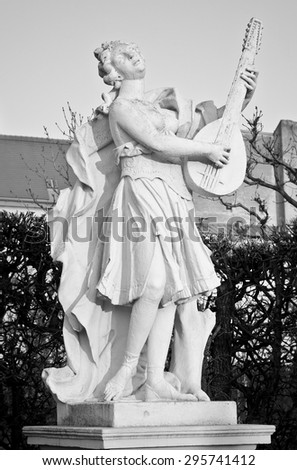 18th Century Statue of a Musician in the Belvedere Palace Gardens, Vienna - stock photo
