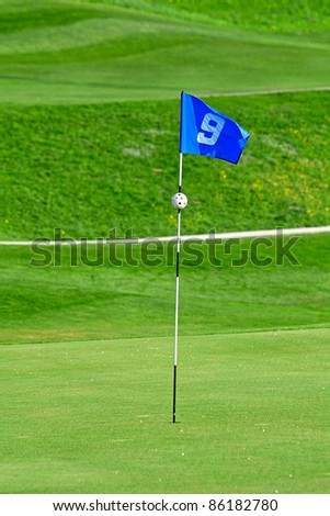 9th flag on the golf course - stock photo