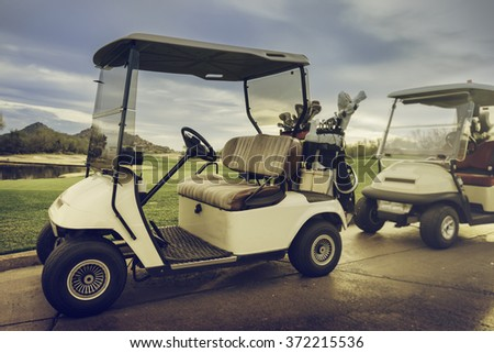 18th hole Golf Carts - stock photo
