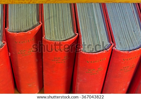 16TH JAN 2016 LIVERPOOL UK Archive of Vogue magazines from 1960's on library shelf - stock photo
