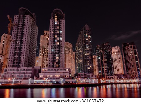 7th January, 2016 - Dubai, UAE: Beautiful nightscape of Dubai Marina lake taken from the JBR 2 lakeside.