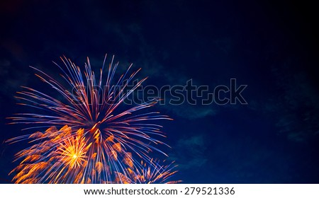 4th July fireworks. Fireworks display on dark sky background. - stock photo