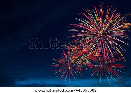 4th July fireworks. Fireworks display on dark sky background. - stock photo