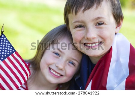 4th of july holiday: happy children with American flag  - stock photo