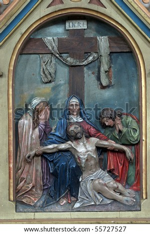 13th Stations of the Cross, Jesus' body is removed from the cross - stock photo