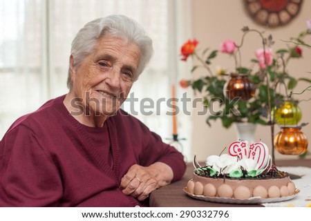 90th years old candles and cake in birthday party for the grandma - stock photo