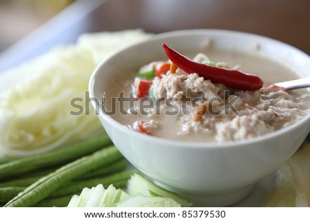 Thai food soya bean dipping sauce in pork with vegetable on woo - stock photo
