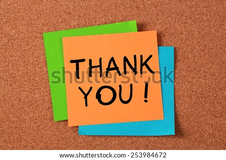 'Thank You!' post-it note pasted on cork board. - stock photo