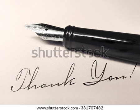 thank you writing and fountain pen on paper - stock photo