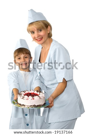 The confectioner and her small assistant are photographed with a cake