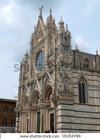 The Duomo of Siena, which was built in the 12th and 13th centuries, is one of the prettiest churches in Gothic style in Italy - stock photo