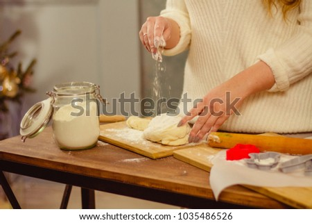 the girl kneads the dough with her hands