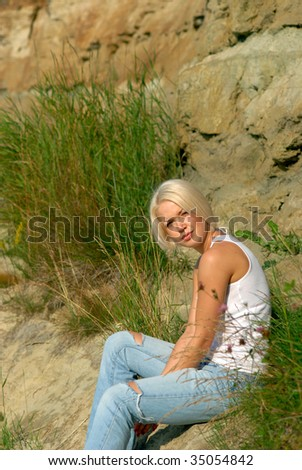 The girl on the rocks. - stock photo