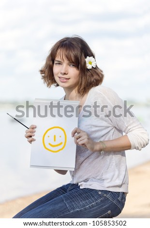 The girl shows a blank leaf - stock photo