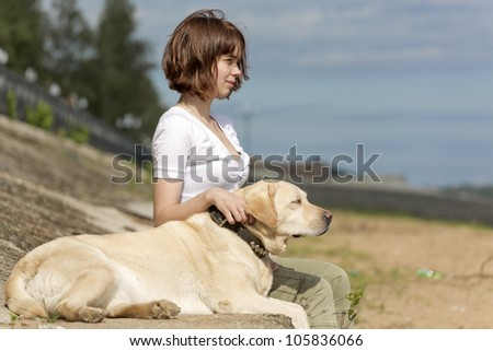 The girl with a dog sit - stock photo