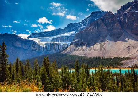 The Glacier Crowfoot over Bow River  in environment of bright striped mountains. Canada, Rocky Mountains, Banff National Park - stock photo