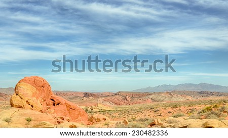 """""""The Guardian"""", Rainbow Vista, Valley of Fire State Park, near Las Vegas, Nevada. The Valley of Fire is a maze of canyons, domes, towers, ridges and valleys. - stock photo"""