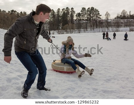The guy carries the girl - stock photo