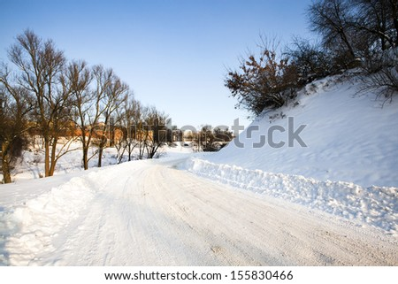 the highway in a winter season. the road is covered with snow - stock photo