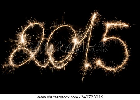 2015 - The inscription sparklers. Happy New Year. - stock photo