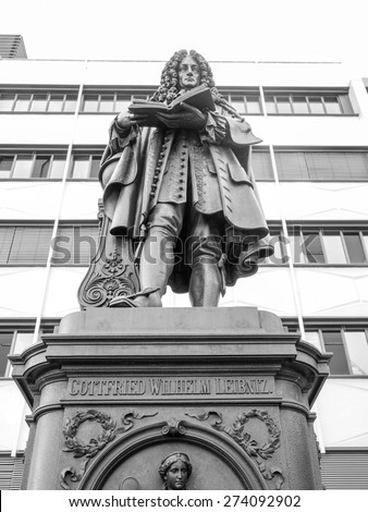 The Leibniz Denkmal monument to German philosopher Gottfried Wilhelm Leibniz stands in the campus of Leipzig University in black and white