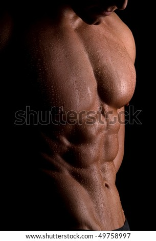 The male body on black background. - stock photo