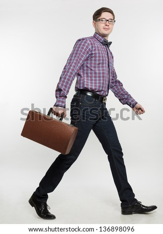 The man goes with a suitcase - stock photo