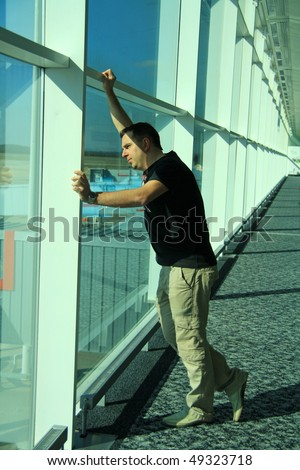 The men expects the plane at the airport - stock photo