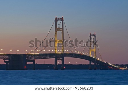 """The Mighty"" -- Mackinac Bridge at twilight - Mackinaw City, Michigan, USA, - stock photo"