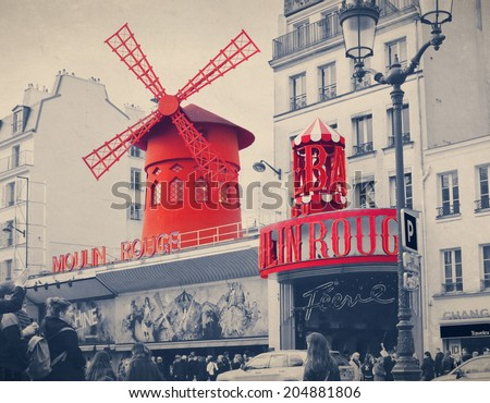 The Moulin Rouge with retro vintage style filter effect. Moulin Rouge is a famous cabaret built in 1889, locating in the Paris red-light district of Pigalle.  - stock photo