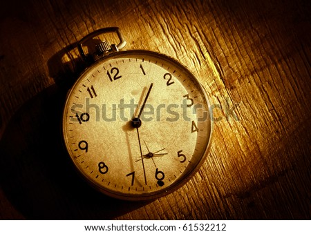 The old clock on the grunge background. High Contrast - stock photo