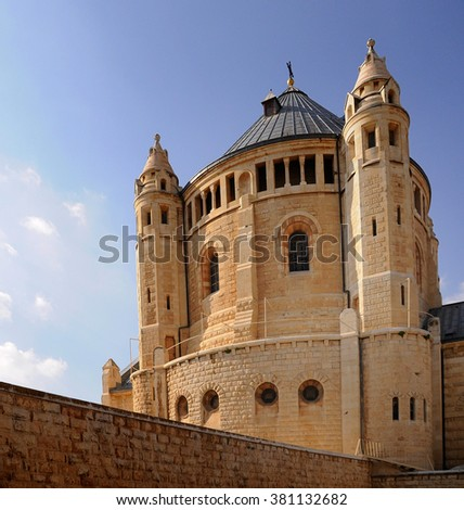 The round formed Church of light stone, black tiles dome and two towers - stock photo
