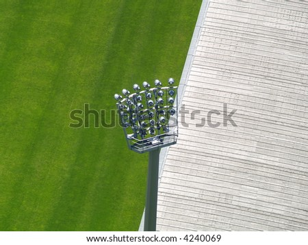 The silhouette of stadium light stand - stock photo