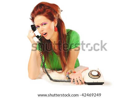 The stylish girl in a green dress is calling isolated