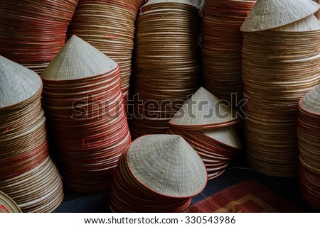 the traditional conical hats of Vietnam girl. This is a woman's hat is the most popular Vietnam. - stock photo