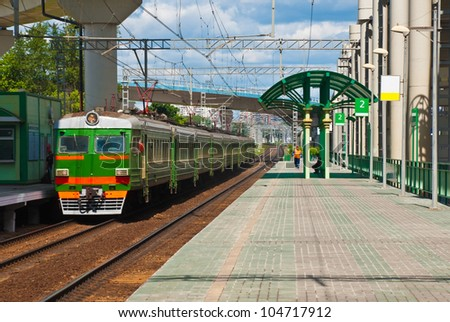 The train at the railway station - stock photo
