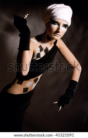 The woman in a suit of queen with chessmen - stock photo