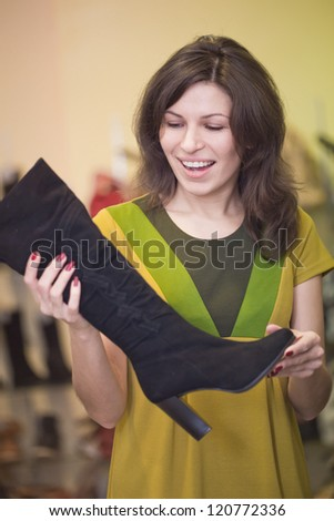 The young woman looks a boot - stock photo