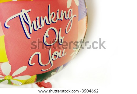 """Thinking of You"" written on a balloon, great for a sentiment card or gift tag - stock photo"