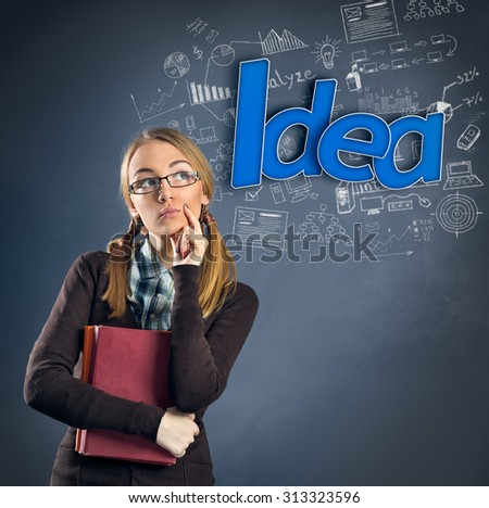 Thinking Schoolgirl have  idea - stock photo