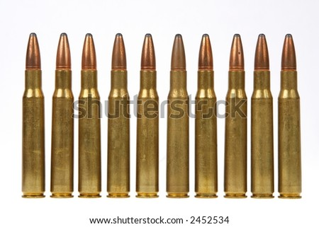 "30-06 ""thirty aught six"" high power rifle ammunition on white - stock photo"