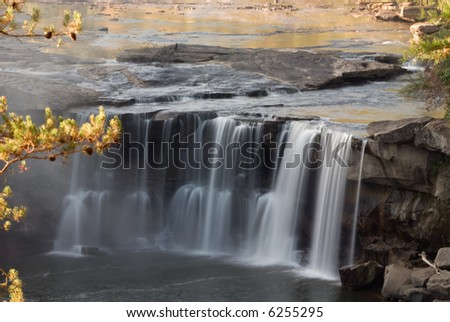 This waterfall  is located near the city of Corbin in Cumberland falls state park in Kentucky.  Photo was taken in mid October during a drought. Even with a drought the waterfall is impressive.