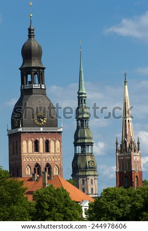 Three church towers in the picture are the Riga Dome cathedral,  St. Saviour's Church and St. Peter's church. - stock photo